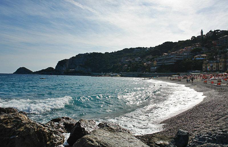 Sandy beach and glittery sea in Bergeggi