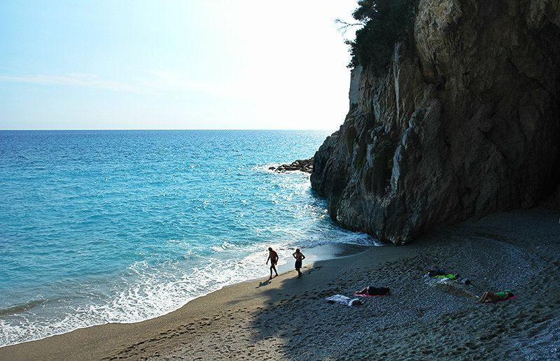 Beach nearby a cliff in Finale Ligure