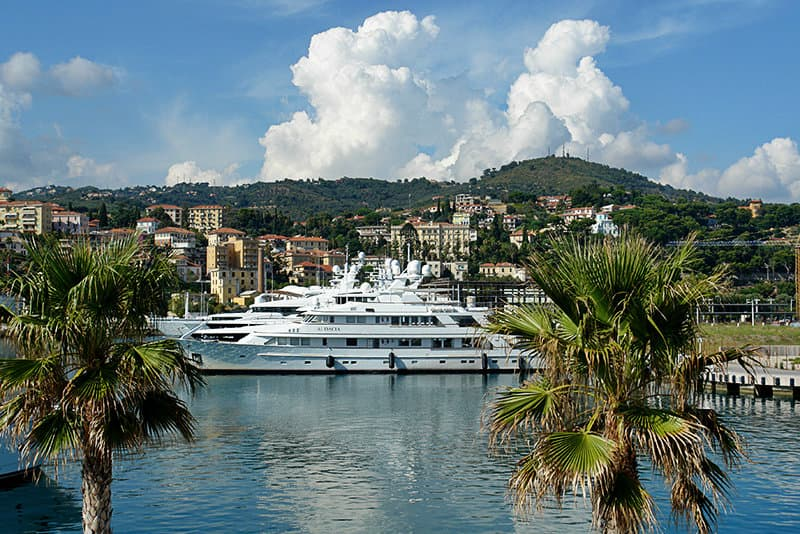 A yacht in between two palm trees in Imperia