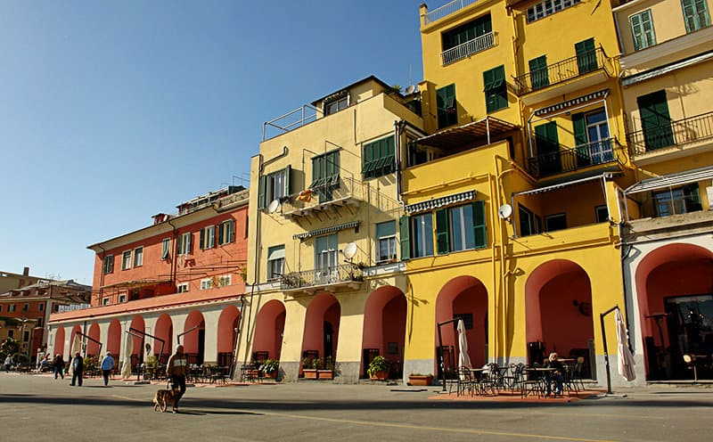 Colorful house facades in Imperia Oneglia by sunset