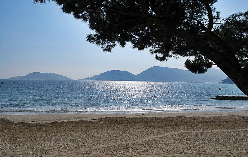 Sandy beach and clear blue sea in Lerici
