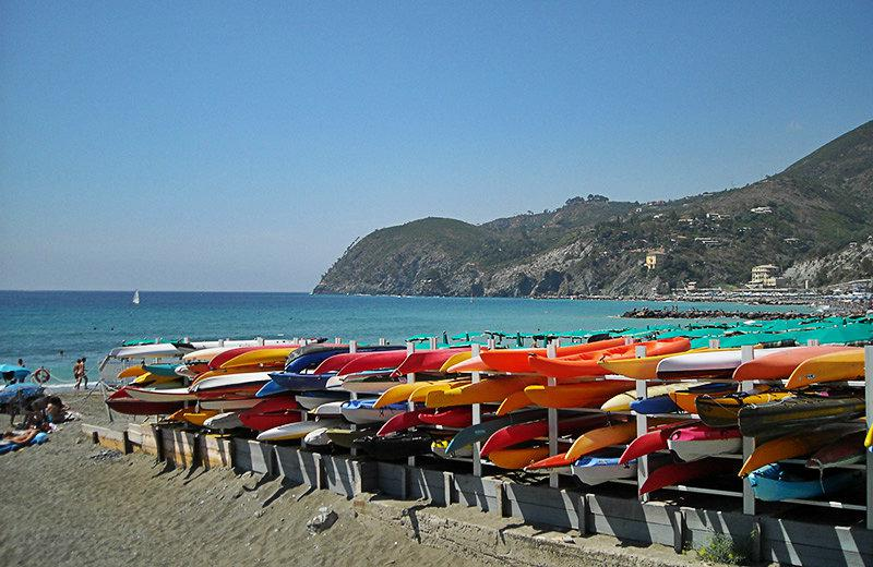 View of colorful canoes and the sea in Lerici