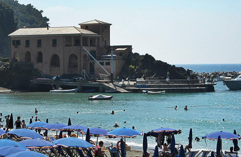 A view of a house, sea and beach in Lerici