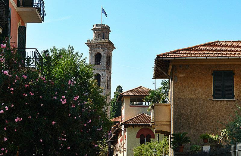 A view of the houses, a church and flowers in Rapallo
