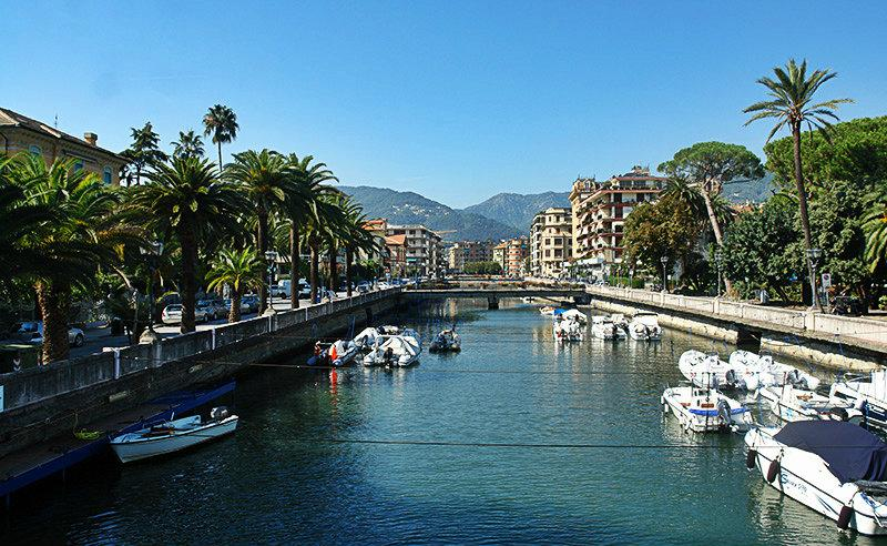 River in between the palm trees in Rapallo