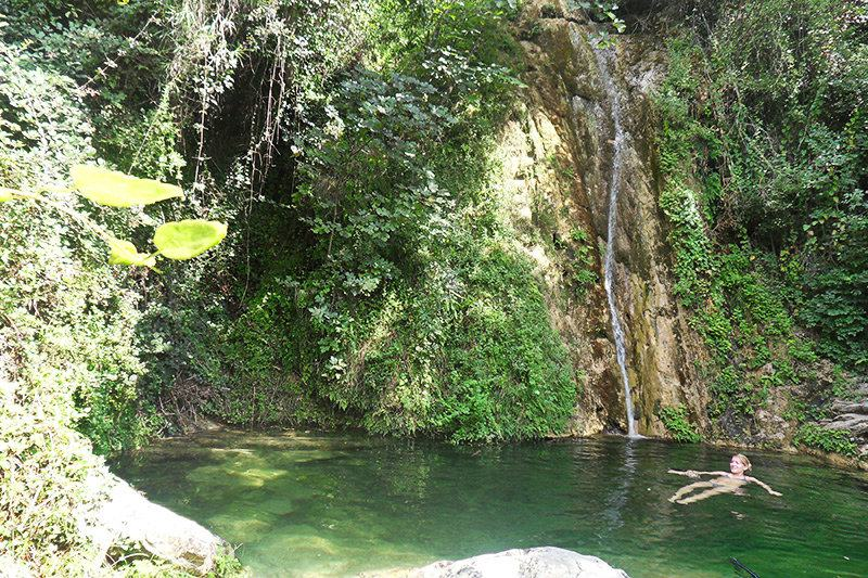A river with a waterfall in Diano Roncagli