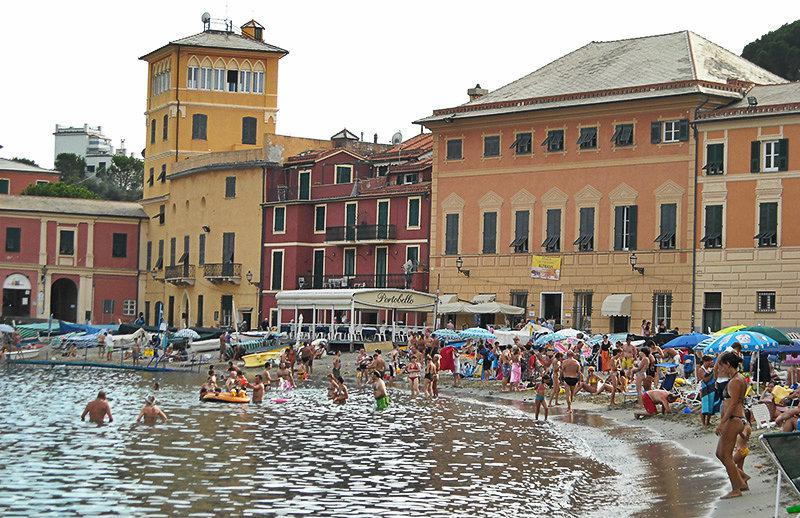 People are enjoying the water at the beach of Sestri Levante