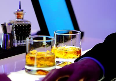Two glasses of whiskey in a nightclub