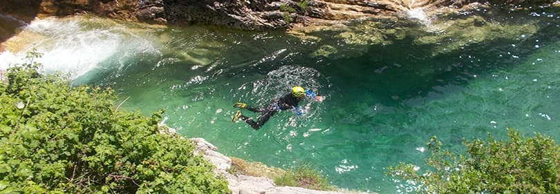 A man is canyoning in Liguria