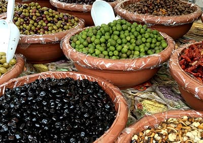 Different kind of olives in a market in Liguria