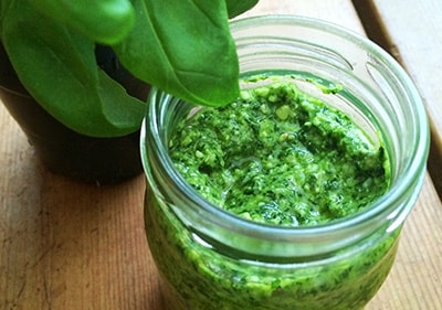 Pesto from fresh basilikum in a glass jar