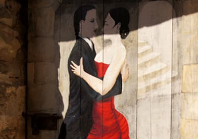 A beautiful painting of a dancing couple on the door in Valloria