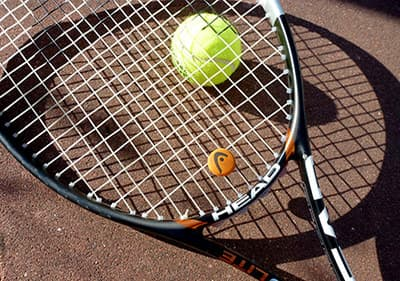 Play tennis in one of the tennis clubs and courts in Liguria