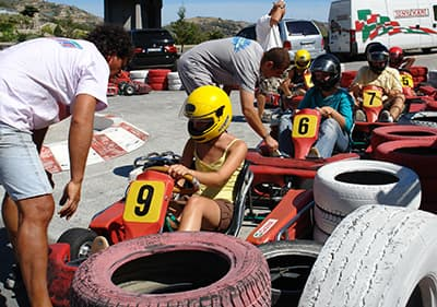 Go kart instructors are preparing drivers for a go kart ride