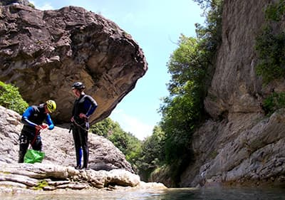 Two men are preparing for canyoning in Liguria