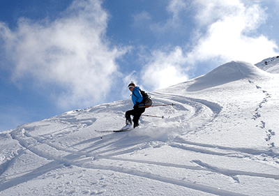 A skier on a moubtain during winter