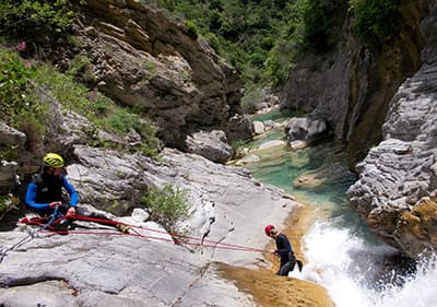 Two men are canyoning in Liguria