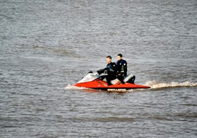 Two persons on a jet ski in Liguria