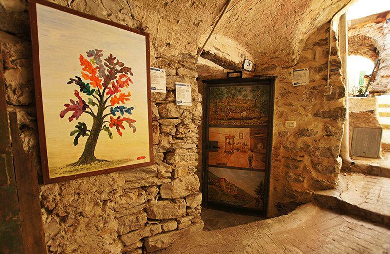Een mooi schilderij aan de deur in Ligurië