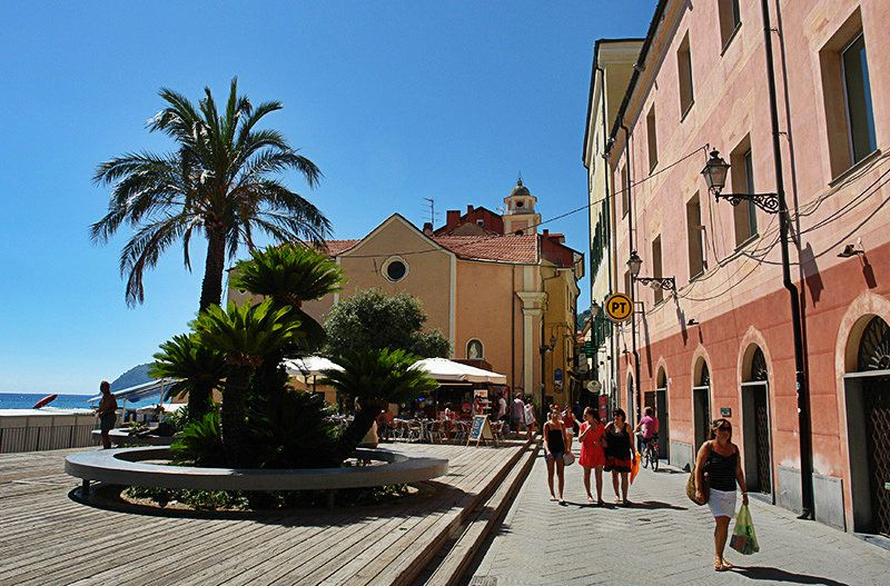 Lovely old town of Alassio in Liguria with palm trees