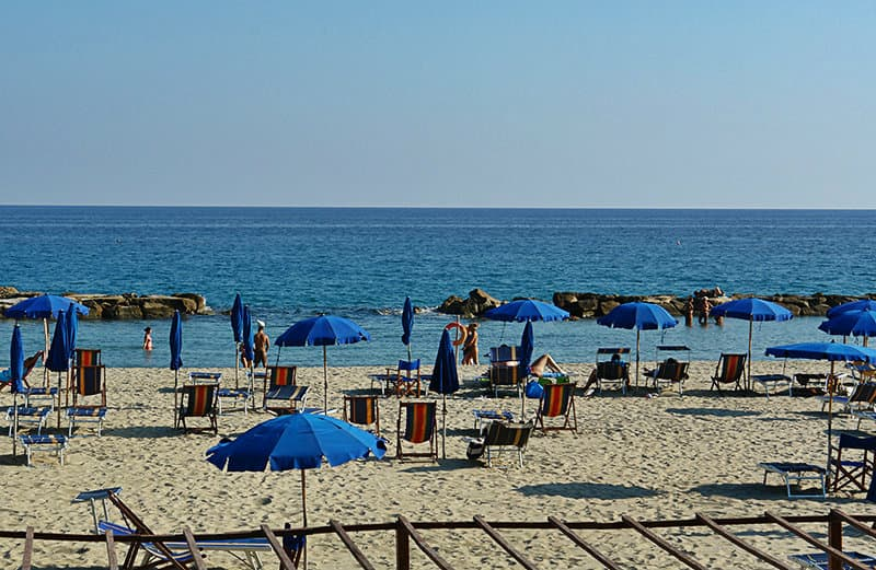 Sun chairs in the sandy beach of Arma di Taggia