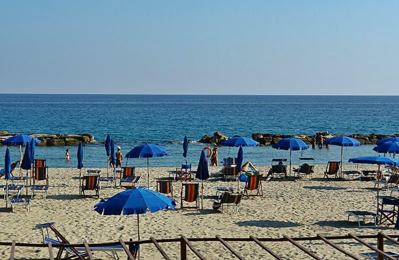Sun chairs in the sandy beach of Arma di Taggia