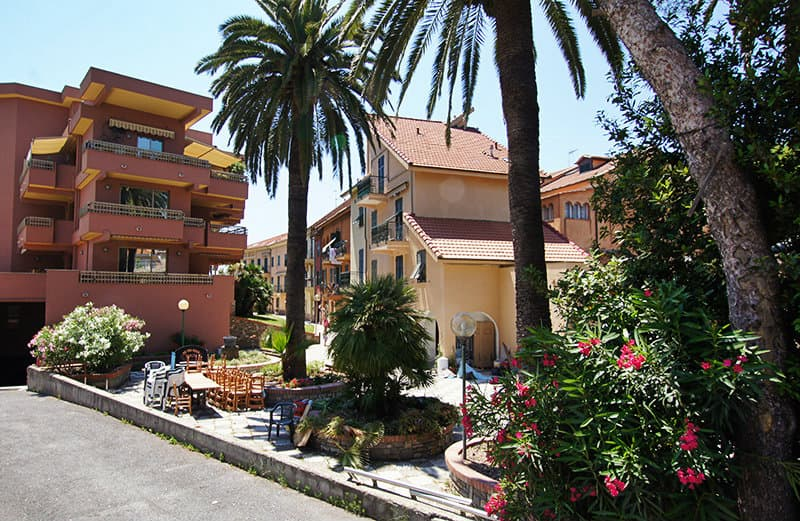 A street in San Lorenzo al Mare with palm trees