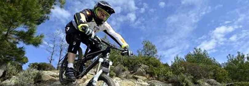 A man is biking with his mountain bike in Liguria