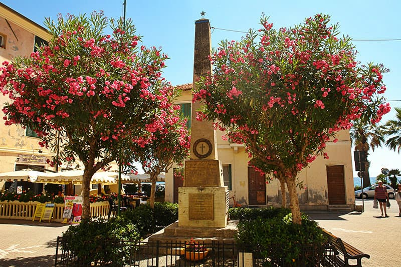 An old sculpture and flower trees in Riva Ligure
